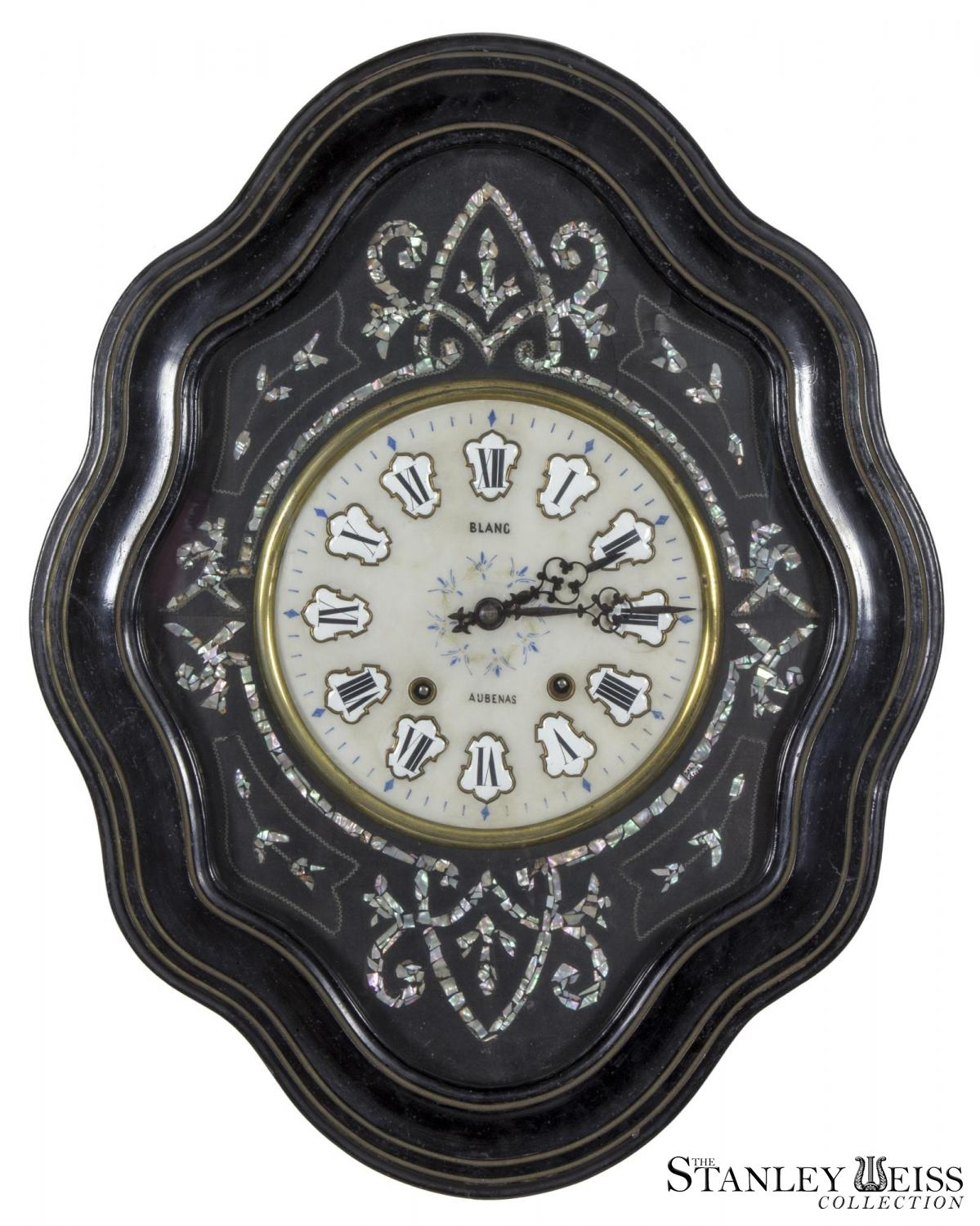 Clock inlaid with mother of pearl
