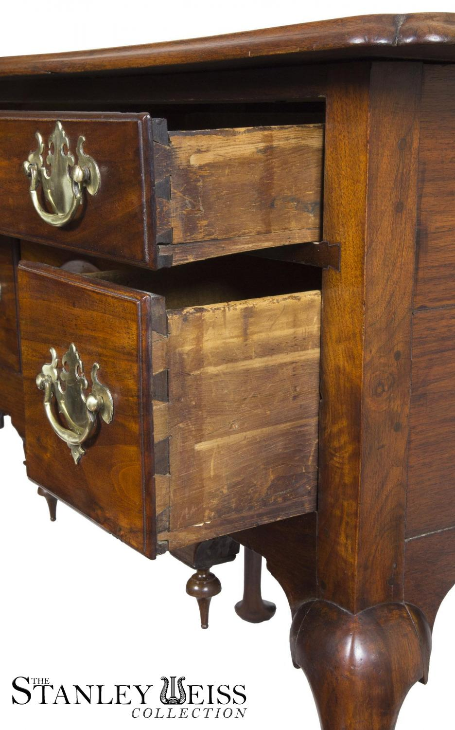 A Highly Figured Walnut Queen Anne Dressing Table Lowboy