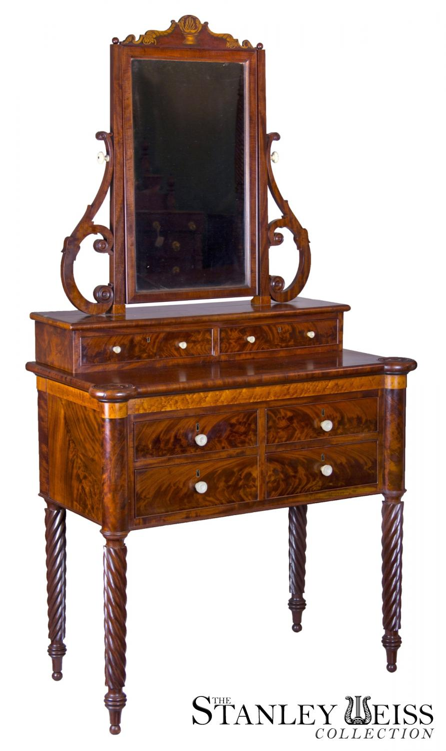 A classical mahogany and birds eye maple dressing table